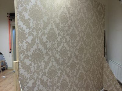 The moveable wall - cream wallpaper